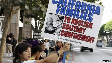 Karen Cuauhtemoc holds a sign during a rally supporting hunger strikers in the California prison system in Los Angeles, California on 29 July 2013