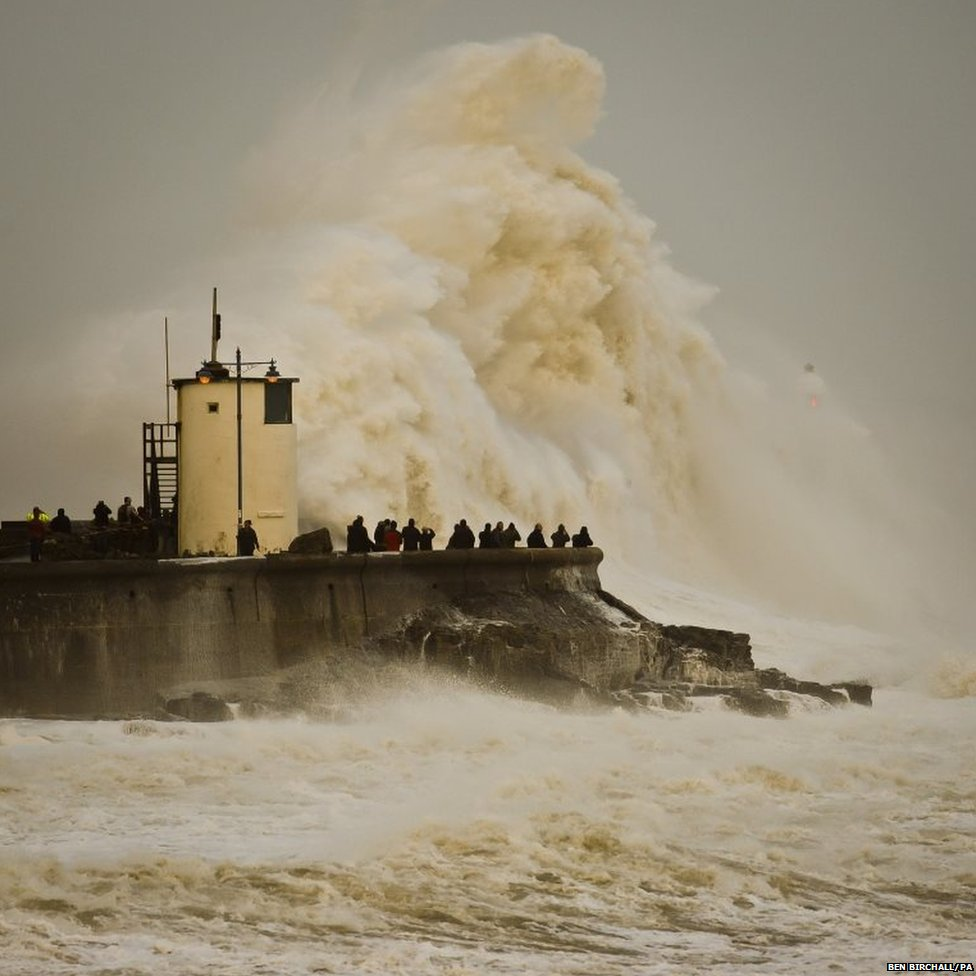 Waves break over Porthcawl harbour, South Wales