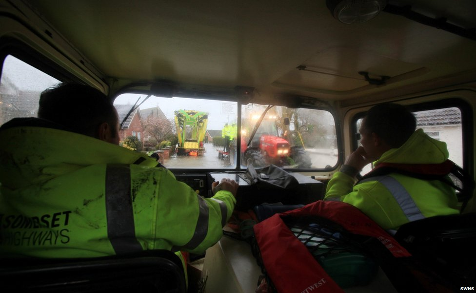 View from the cab of an all terrain vehicle being used to get around flooded Moorland
