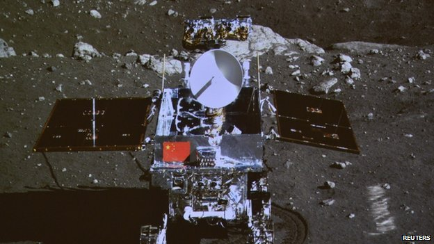 A photograph of the giant screen at the Beijing Aerospace Control Center shows photo of the Yutu, or Jade Rabbit lunar rover, taken by the camera on the Chang'e 3 probe during the mutual-photograph process, in Beijing, 15 December 2013