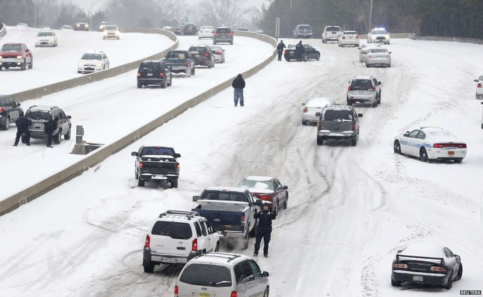 Motorists struggle up a hill in Charlotte, North Carolina, 12 February