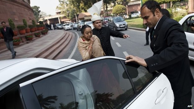 Indian Speaker of Lower House of Parliament (Lok Sabha) Meira Kumar (C) leaves Parliament after protests inside the parliament building in New Delhi on February 13, 2014