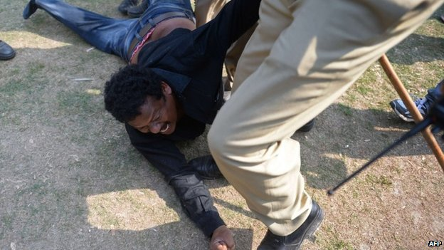 A demonstrator demanding a separate state of Telangana is detained by Indian policemen outside the parliament building in New Delhi on February 13, 2014