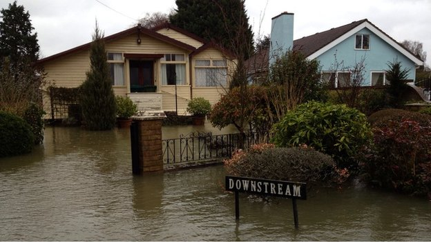 Houses along the flooded Towpath in Shepperton