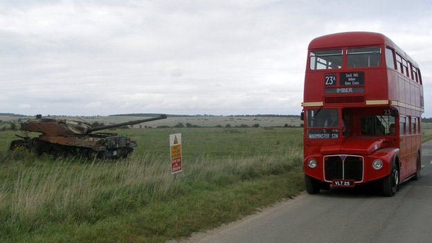 Bus by a tank on Salisbury Plain