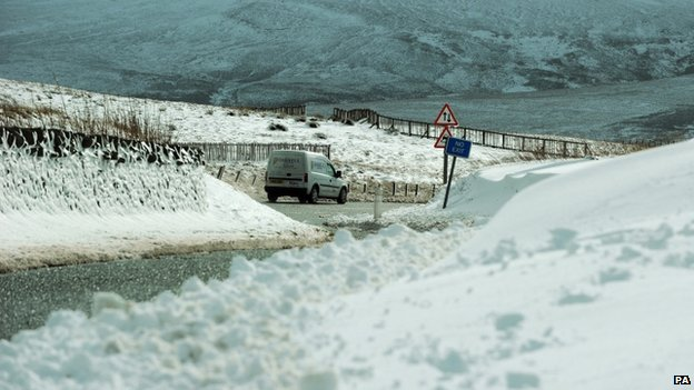 A car drives through snow on the Northumberland border