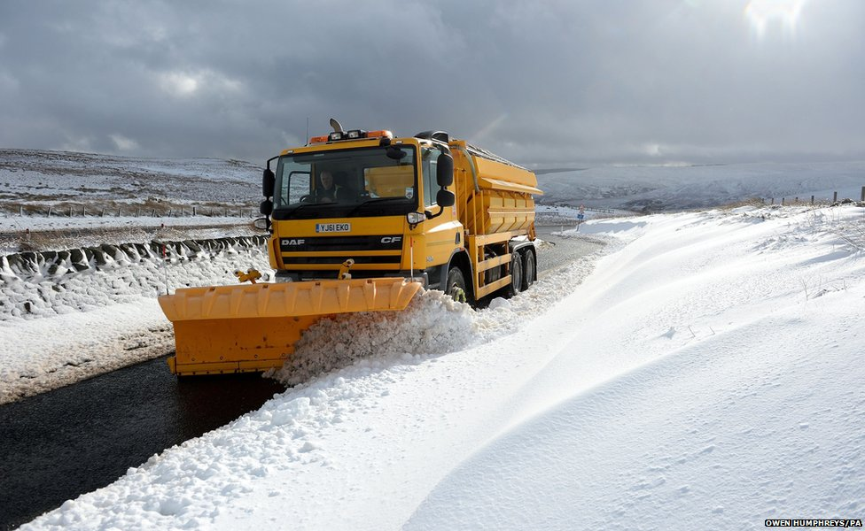 A snow plough clears snow on the Northumberland border