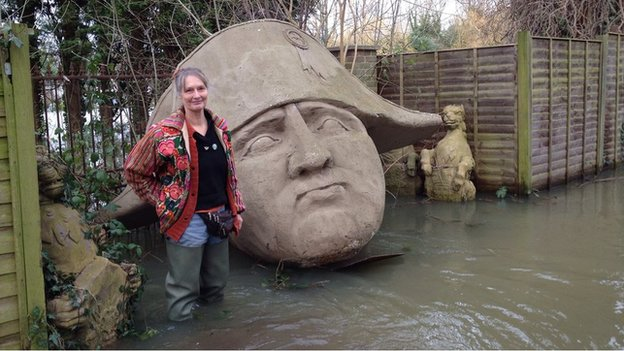 Sally Pemberton and a giant head of Napoleon in her garden