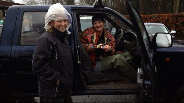 Vivienne Leighton (left) and Sally Pemberton do rounds in Sally's 4x4 along the flooded Towpath