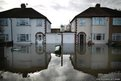 Flood water surrounds housing in Staines-Upon-Thames, England