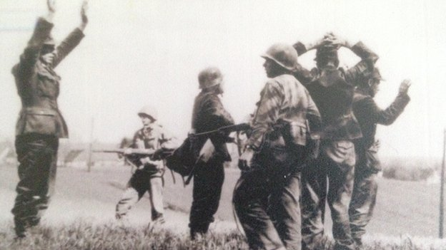 German soldiers surrendering to American GIs