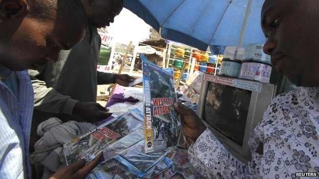 People browse DVDs for sale in Nairobi, Kenya - 2014