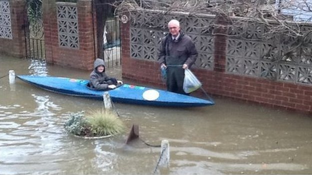 Schoolboy in a canoe in Thames Ditton