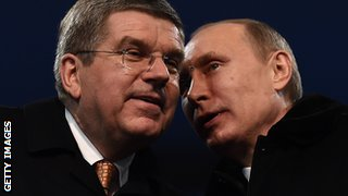 Vladimir Putin chats to Thomas Bach during the opening ceremony
