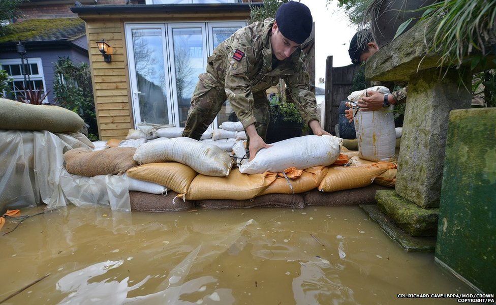 The Army has been laying sandbags in Chertsey where flood defences have been put in to protect about 200 homes.