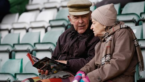 elderly couple at football match