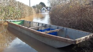 Boat in flood water in Grimley, Worcestershire