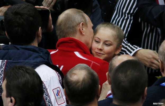 Russian President Vladimir Putin congratulates Yulia Lipnitskaya of Russia after the Team Figure Skating event
