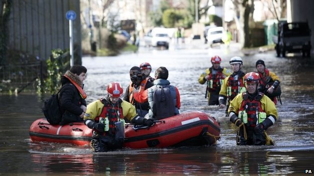 Members of the RSPCA rescue residents in Egham