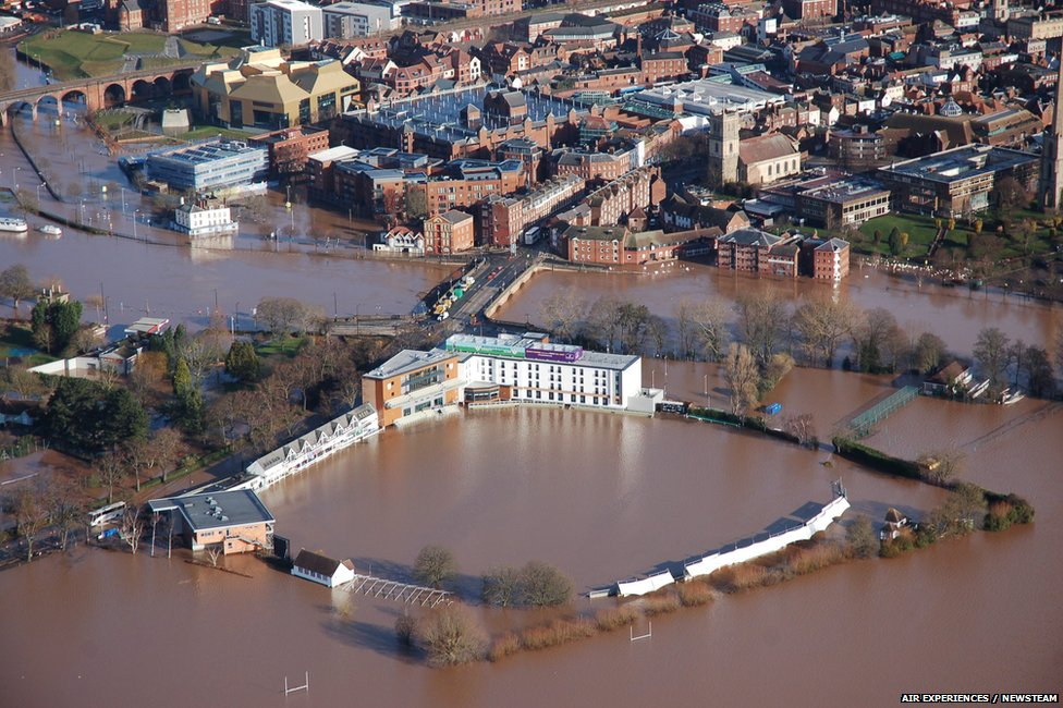 The River Severn in flood-hit Worcester earlier reached its highest level in recent years. Here you can see the stands of Worcestershire County Cricket Club surrounded by water.