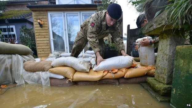 Soldiers placing sandbags around houses  on Bridge Street, Chertsey