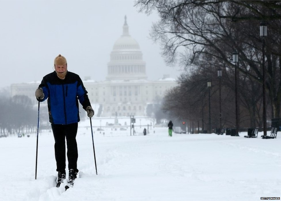 A man cross-country skis on the National Mall in Washington DC in 13 February 2014