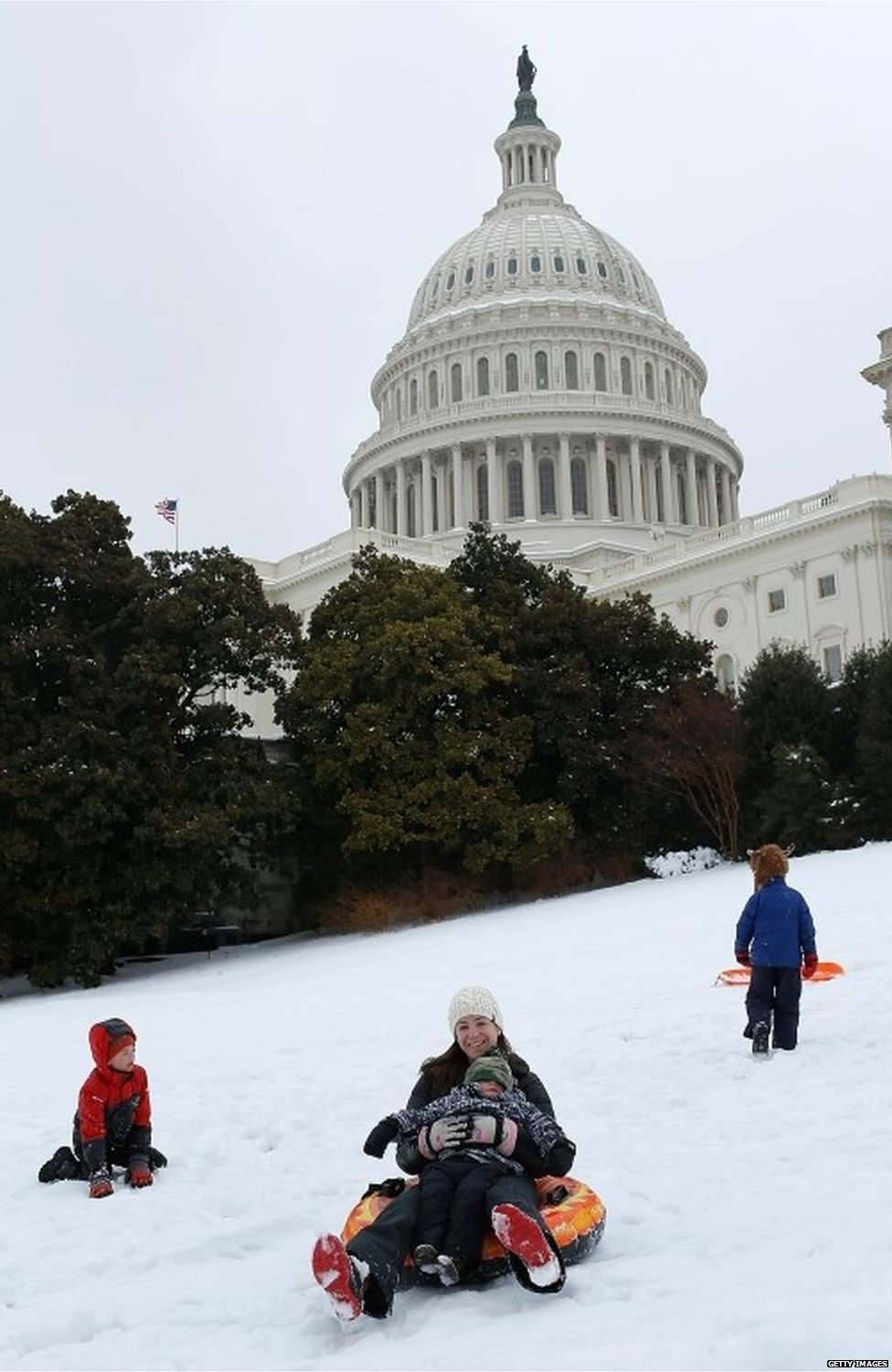 Members of the Miller family sled on the west lawn of the US Capitol in Washington DC on 13 February 2014