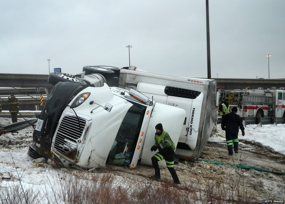 An overturned lorry in Oxon Hill, Maryland, on 13 February 2014