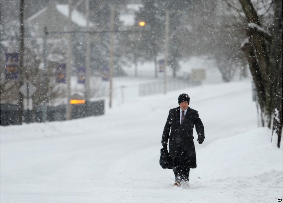 Carl Adkins, 51, has the high street to himself as he walks two miles to his job at a hospital in West Chester, Pennsylvania, on 13 February 2014