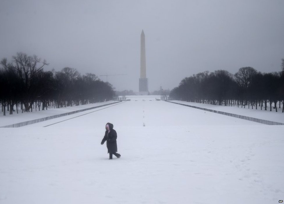 A woman near the Washington Monument in Washington DC on 13 February 2014