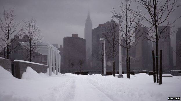 The Empire State Building seen from a snowy path in Queens, New York 13 February 2014