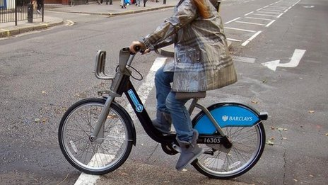 Person riding  Barclays Cycle Hire bike