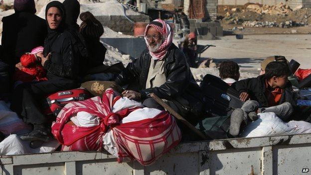 A Syrian family flees Yabroud in the back of a truck. Photo: 12 February 2014