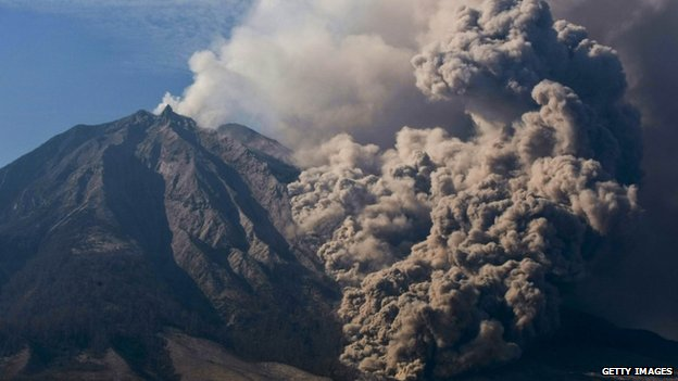 Mount Sinabung spews smoke in Karo District, North Sumatra, Indonesia, 12 February 2014