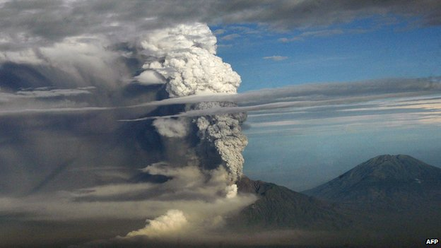 A plume of gas and ash billowing from the Mount Merapi volcano during an eruption on 4 November 2010