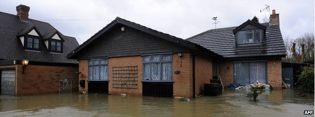 Floodwater surrounds a property in the village of Wraysbury, west of London