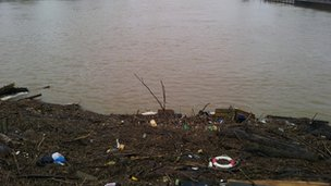 Flood debris against bridge
