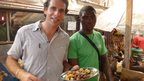 Mark Beaumont tries a pork dish in Cameroon