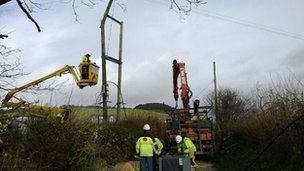 Engineers fix power lines