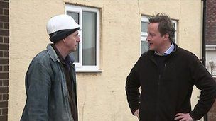 Prime Minister David Cameron inspecting damage to a property in Blackpool, Lancashire