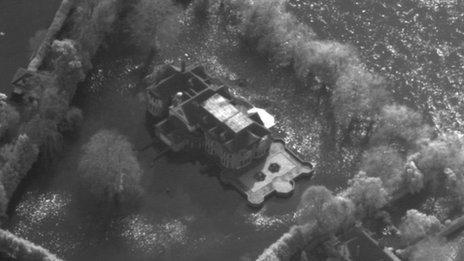 A highly detailed aerial picture of a flooded home captured by the RAF's Tornado jet