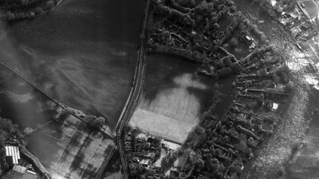 An aerial image of a flooded community taken by the RAF's Tornado jet