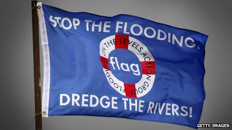 A protest flag asking for river dredging