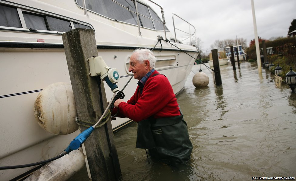 Derrick Foxwell attempts to dislodge his boat