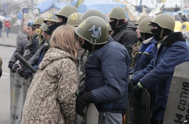 A young woman kisses an opposition activist on Kiev's Independence Square, 14 February