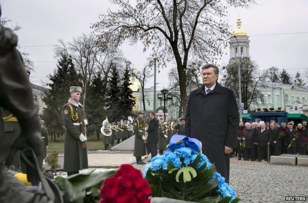 Ukrainian President Viktor Yanukovych attends a military memorial in Kiev, 14 February