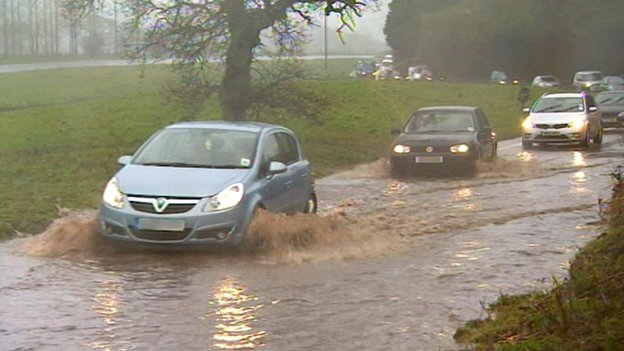 Cars on flooded road in Clyst St George