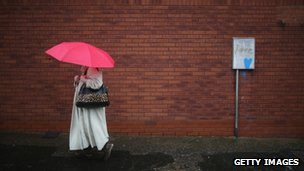 A woman with umbrella in Worcester