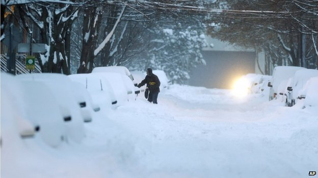 Motorists in Albany, New York, and across the US north-east were forced to dig out their cars from the heavy snow
