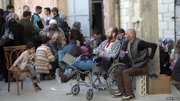 Refugees from besieged parts of the Old City of Homs shelter in a school in a government controlled part of the city, on 14 February 2014, according to Sana